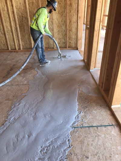 Insul-Flow employee installing gypcrete flooring in new construction