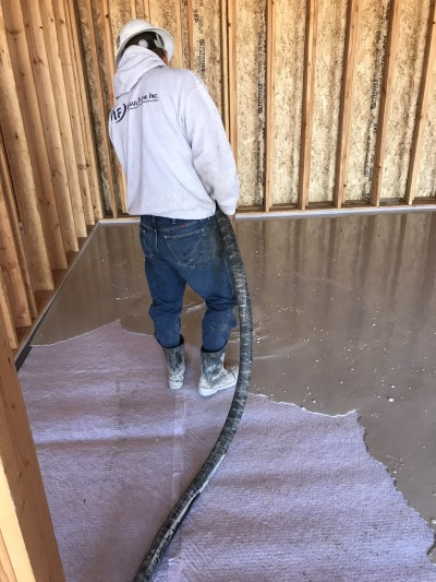 Gypcrete flooring being installed over sound matting underlayment